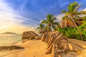 Anse Source Dargent At Sunset. Seychelles, La Digue. Landscape Of Palm Trees And Rock Stone Of Grani poster