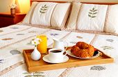 stock photo of bed breakfast  - Tray with breakfast on a bed in a hotel room - JPG