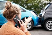 Female Motorist Involved In Car Accident Calling Insurance Company Or Recovery Service poster