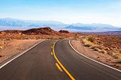 Winding road  through the desert landscape. White Domes Road (Mouse's Tank Road), Nevada, United S poster