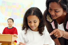 image of student teacher  - Teacher and student in a classroom at school - JPG