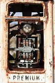picture of bowser  - Very old rusty derelict petrol pump with analog dials - JPG