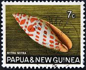A stamp printed in Papua New Guinea shows shell Mitra mitra (Episcopal miter) circa 1969