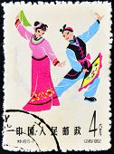CHINA- CIRCA 1962. A stamp printed in China depicting traditional wear for women and men circa 1962