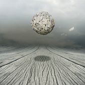 stock photo of metaphysical  - Artistic metaphysical background representing a ball sculpture floating in the air above a wooden floor with the sky on the background - JPG