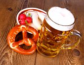 foto of pretzels  - Beer with pretzel white sausage and radish top wiew - JPG