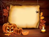 stock photo of halloween  - Halloween background with pumpkins paper candle spider web and autumn leaves on wooden planks - JPG