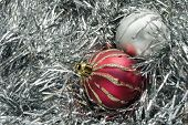 Two Christmas Balls On Tinsel