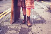 pic of thrift store  - The Legs Of A Young Woman Standing In The Street With Picture Frame - JPG