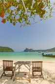 stock photo of koh phi-phi  - table and chairs on beautiful bay of Koh Phi Phi Thailand - JPG