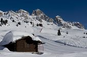 stock photo of chalet  - Chalet under the snow in the idyllic landscape of the dolomiti in Val di Fassa - JPG