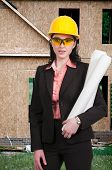 picture of ppe  - A Female Construction Worker on a job site - JPG