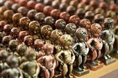 Rows Of Manneken Pis Metallic Replicas In Different Colors