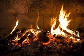 stock photo of flame  - Fireplace with a blazing flames - JPG
