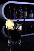 Cocktail With Cola And Lemon On A Bar