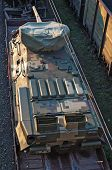 stock photo of railcar  - The new tank transported by train - JPG