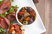 picture of antipasto  - Delicious black olives and stuffed green olives with sundried tomato on a antipasto platter - JPG