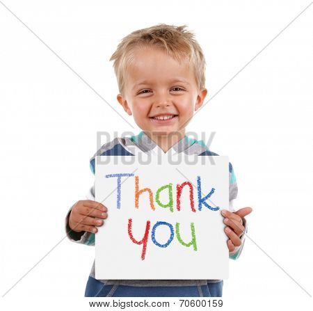 Child holding a crayon thank you sign standing against white background poster