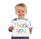 picture of cute innocent  - Child holding a crayon thank you sign standing against white background - JPG