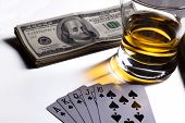 image of splayed  - poker  cards dollars and a whiskey glass - JPG
