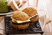image of veggie burger  - Vegetarian burger with grilled cheese, eggplant and pesto