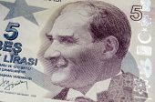 stock photo of turkish lira  - Portrait of the late Turkish President on a banknote for five Lira - JPG