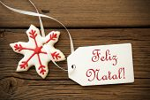 foto of natal  - Feliz Natal which is Portuguese and means Merry Christmas on a Label with a red white Christmas Star Cookie - JPG