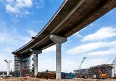 stock photo of trestle bridge  - Elevated road construction at sunny day in Russia - JPG