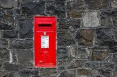 image of postbox  - Red postbox set flush into a wall - JPG
