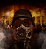 stock photo of war terror  - A soldier is wearing a gas mask in a polluted scary city with smokestacks in the background for a war or hazard concept - JPG