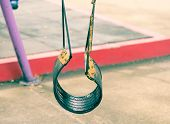 stock photo of tire swing  - Empty tire swing hanged in playground retro - JPG