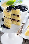 picture of curd  - Lemon curd blueberry vanilla layer cake on a stand - JPG