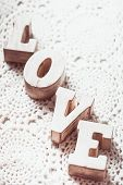 foto of doilies  - Love wooden letters on the crochet doily vintage styled - JPG