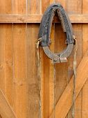 picture of yoke  - Horse collar hanging on a wooden door - JPG