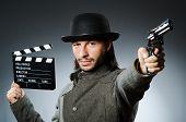 stock photo of top-gun  - Man with gun and movie clapboard - JPG