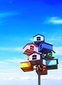foto of nesting box  - Colorful nesting boxes on blue sky - JPG