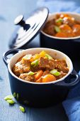pic of stew pot  - beef stew with potato and carrot in blue pot  - JPG
