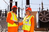 stock photo of substation  - smiling technicians meeting in electrical substation - JPG