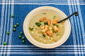 foto of peas  - Pea soup with macaroons  and croutons with peas around - JPG