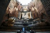 stock photo of chums  - Phra Achana in Wat Si Chum at Sukhothai Historical park - JPG