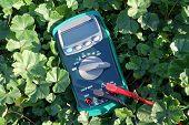 stock photo of  multimeter  - the Digital multimeter under a bright sunlight - JPG