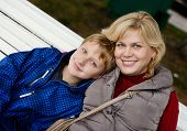 picture of ordinary woman  - a middle age woman and son outdoors - JPG