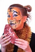 stock photo of tigers  - Girl tiger with the piece of raw meat - JPG