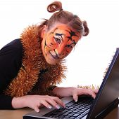 pic of tigers  - Girl in appearance a tiger with a notebook - JPG