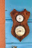 pic of barometer  - Vintage barometer and hygrometer on the blue shutters - JPG