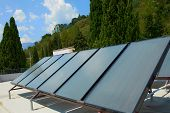 pic of roof-light  - Solar water heating system on the red roof - JPG