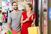 image of mall  - Couple at shop window in mall shopping - JPG