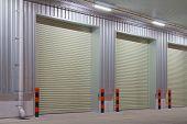 stock photo of roller shutter door  - Exterior of factory with shutter door - JPG