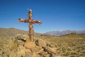 stock photo of arid  - Christian cross on peruvian arid landscape near Canon del Colca - JPG
