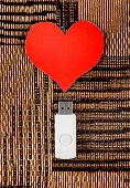 pic of usb flash drive  - USB Flash Drive with Heart Shape on the Fabric Background - JPG